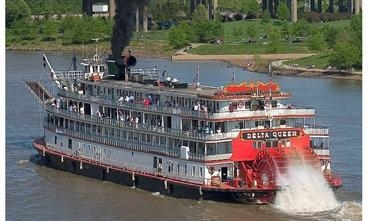 DELTA QUEEN, approaching a bridge with funnel lowered, has not sailed since 2008. © Delta Queen Steamboat Company