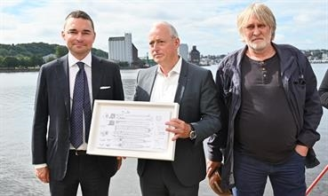 Lars Windhorst (left), Martin Hammer (middle) and Thomas Jansen (right) with a framed GA plan of the new ro-ros Windhorst plans to build at the 'new' FSG. © FSG