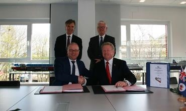 Contract signing with Eystein Eriksrud, Siem Shipping (back left), Bernard Dwyer, TT-Line Company Pty Ltd (back right), Rüdiger Fuchs, FSG (front left) and Mike Grainger, TT-Line Company Pty Ltd (front right) © FSG